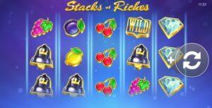 spelplanen för spelet Stacks Riches som visar olika symboler i form av bland annat olika fruker och diamanter