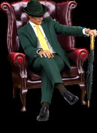 Mannen Mr Green sitter i en fotölj med ett grönt paraply till hands