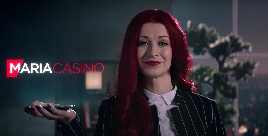 Röd hårig kvinna från Maria casino-reklam