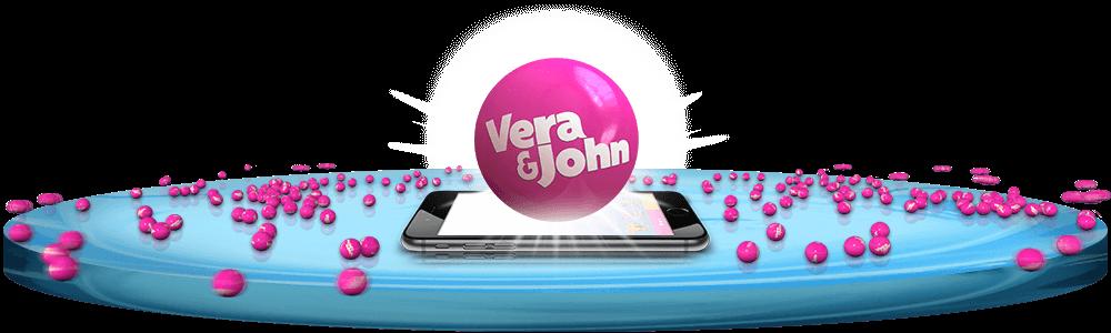 logon för Verajohn casino över en mobiltelefon med flera rosa bollar i bakgrunden